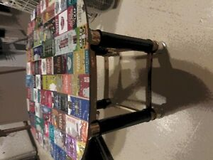 Custom coffee / end table wrapped in Blunt wrappers. Glass table top