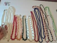 Lot of 12 vintage plastic beaded necklaces. white, orange, green, red + more