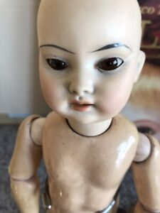 """Antique 14"""" Bisque Oriental Jointed Doll."""