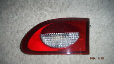 1997--2002 CHEV. CAVALIER R.H. TAIL LIGHT (INTSIDE) TRUNK  LID  MOUNTED