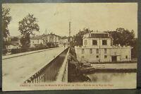 cpa 54 charmes pont sur la moselle et le canal de l'est entree rue du pont