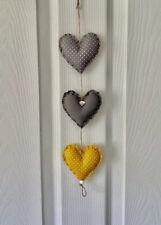 Handmade fabric Hanging Hearts 3 in Grey and Ochre.
