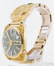 Bulova Accutron wrist watch w/ day & date, 14k case w/ gold nuggets, 10k band