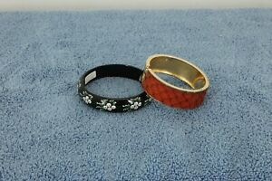 2 COSTUME BRACELETS BLACK RING W/WHITE FLOWERS SPRING BRASS PLATED W/RED INLAY