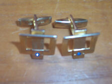 A Pair of Gilt Triangle Brand Buckle Styled Cufflinks with Blue Stone