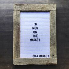 Reclaimed barn wood with white felt letter board and black letters