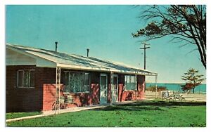 1967 Dimmick's Colonial Cottages, Tawas Bay, MI Postcard *5F28