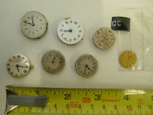 Assortment of vintage mechanical wound wrist watch movements and omega dial STEA