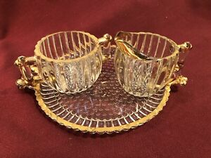 Beautiful Glass Sugar and creamer with matching glass tray w/ Gold Colored Trim