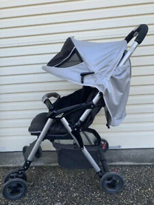 Combi Well Carry Pram For Sale With FREE Combi compact rain cover