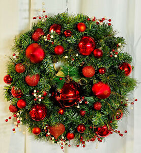 Handmade Christmas Evergreen Wreath With Red Ornaments, And A Big Red Bell