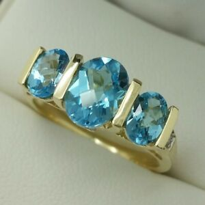 9ct Yellow Gold Blue Topaz 3 Stone Ring with Diamond, Finger Size O
