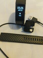 Black Fitbit Charge 3 with Charger and Extra Leather Band