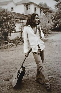 Bob Marley Leaning on his Guitar In Sepia Poster 24 x 36