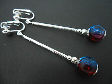 A PAIR OF SILVER PLATED BLUE & RED CRACKLE BEAD LONG CLIP ON EARRINGS. NEW.