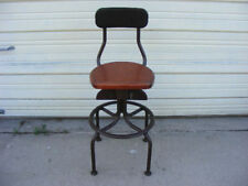 Old Western Electric telephone switchboard operator chair with a wood seat