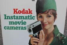 VINTAGE CARDBOARD EASEL SIGN - KODAK INSTAMATIC MOVIE CAMERAS - CHRISTMAS ELF