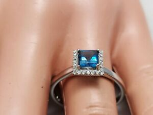 1.87Ct Genuine Natural Blue Topaz  And Diamond Ring In Solid 14K White Gold.