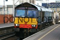 UK DIESEL TRAIN RAILWAY PHOTOGRAPH OF CLASS 66 66421 LOCO. RM66-566
