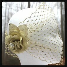 Gold flower on Gold birdcage veil made with rhinestones