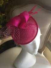 Hot pink/fuchsia fascinators/hatinators with loops, feathers and netting! 1 only