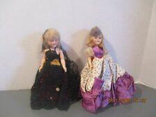 """2 Vintage Hard Plastic 7"""" Dolls"""