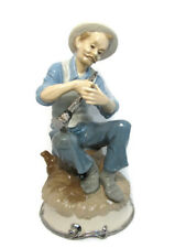 Narco Man Playing Horn Sitting on A Rock Figurine Statue Blue