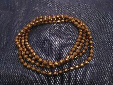 Great string strand of bronze tone plastic faceted beads approx 120 cm long