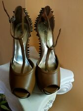 Shoes by Wild pair Brown with bronze gold studs in a six and a half