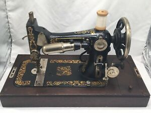 vintage national sewing machine in original wooden case plus accesories Rare