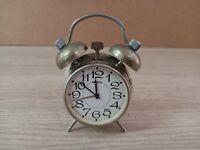 Vintage mechanical miniature alarm clock RAKETA 1980s USSR.