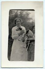Woman holds Jack Russell Terrier pet dog; photo postcard Rppc c. 1910