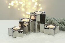 36841 Leuchter Sternschnuppe aus Keramik silber für 4 Teelichter in Sternform