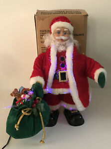 2004 Avon Dazzling Fiber Optic Santa With Bag Of Toys Plays Christmas Carols