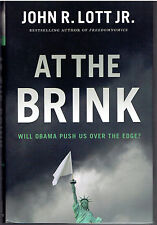 At The Brink : Will Obama Push Us Over the Edge? by John R. Lott Jr. - SIGNED