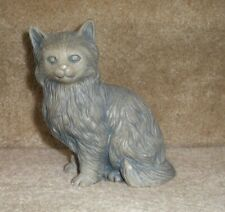 Grey cat figure sculpture made out of Mt St Helen's volcanic ash