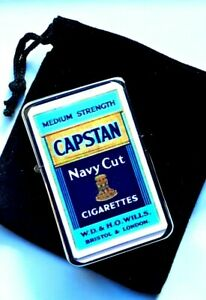 Petrol Lighter with CAPSTAN NAVY CUT Cigarettes advert in black velvet pouch.