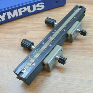 Olympus OM system focusing rail .