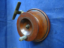 A VINTAGE TOURNAMENT MODIFIED WOODEN FISHTAIL NOTTINGHAM CENTREPIN REEL