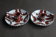 Matching pair of unusual (Devon?) slipware candle holders in excellent condition
