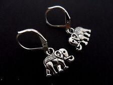 A PAIR OF  CUTE LITTLE TIBETAN SILVER DANGLY ELEPHANT LEVER BACK HOOK EARRINGS.
