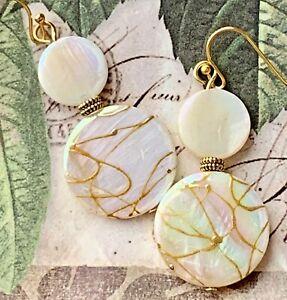 Ivory Shell with Gold Swirl Dangle Earrings.