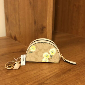 Crescent Pouch Bag Charm In Signature Canvas With Daisy Print Keychain