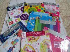 2 SHEETS OF WRAPPING PAPER AND 2 GIFT TAGS