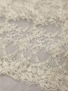 White Beaded Sequin Tulle net scalloped edge wedding dressmaking craft fabric