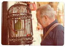 Vintage 80s PHOTO Man Looking at Parrot In Birdcage