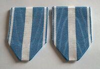 FRANCE: Lot de 2 rubans NEUFS pliés pour la médaille Coloniale ou Outremer.