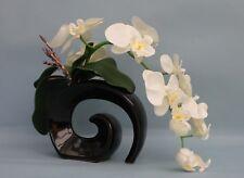 HANDMADE ARTIFICIAL SILK CREAM ORCHID, LEAVES SET IN BLACK FOSSIL CERAMIC VASE