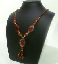 Collares y colgantes de joyería con gemas marrones sin tratar
