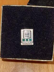 General Motors 10k White Gold Emerald GM truck & bus service lapel pin In Box